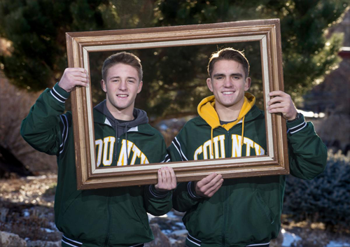 Twin brothers Grant (left) and Hunter Willits hold a picture frame and pose for a portrait outside their Pueblo County home. (CHIEFTAIN PHOTO/FILE)